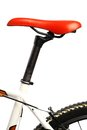 Red bicycle saddle color detail of the of a Royalty Free Stock Images