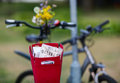 Red bike basket with a newspaper inside Royalty Free Stock Photo