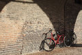 Red bike italy an old leaning against a brick wall Royalty Free Stock Images