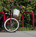 Red bike with white basket at a stand Royalty Free Stock Image