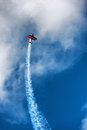 Red biplane aircraft in the blue sky Royalty Free Stock Photo