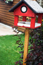 Red bird house waiting for new occupants Stock Images