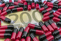 Red and black capsules up ticket of 200 euros Royalty Free Stock Photo