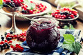 Red and black currants. red currant jam with fresh berry Royalty Free Stock Photo