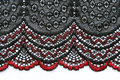 Red and black flowers lace material texture macro shot Royalty Free Stock Photo