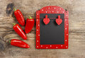 Red and black memo board with clothes pegs in heart shape Stock Photography