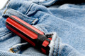 Red and black screwdriver in jeans pocket Royalty Free Stock Photo
