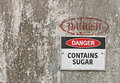 Red, black and white Danger, Contains Sugar warning sign Royalty Free Stock Photo
