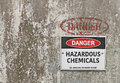 Red, black and white Danger, Hazardous Chemicals warning sign Royalty Free Stock Photo