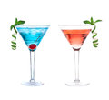 Red and blue alcohol cosmopolitan cocktails drinks with mint in martini glass isolated on a white background Stock Photo