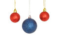 Red and blue baubles glitter christmas isolated against white Royalty Free Stock Photo