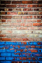 Red and blue brick wall texture background with chipped worn flacked off paint Royalty Free Stock Images