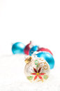 Red, blue and colourful Christmas  baubles on snow Stock Images