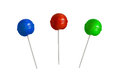 Red, blue and green lollipop isolated on white background. Royalty Free Stock Photo