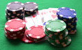 Red, blue, green, white and black poker chips and royal flush Royalty Free Stock Photo