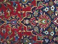 Red blue Persian rug on the floor with various shapes