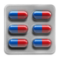Red and blue pills in blister packaging isolated on white background Royalty Free Stock Photo