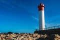Red Blue Rocks Lighthouse Royalty Free Stock Photos