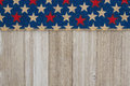 Red and blue stars burlap ribbon on weathered wood background Royalty Free Stock Photo