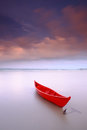 Red boat anchored durimg sunset beautiful sampan Royalty Free Stock Photography