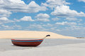 Red boat little with dune and beautiful sky on the background Stock Images
