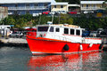 Red boat by a small caribbean fishing village Royalty Free Stock Image