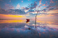 Red boat under morning sky Stock Photography