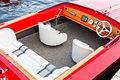 Red boat with white interior classic in diagonal view Royalty Free Stock Images