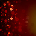 Red bokeh christmas background bubbles beautiful orange with black border and shimmering white lights or abstract falling snow Stock Photography