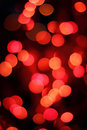 Red bokeh spots on a dark background Stock Images