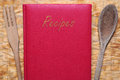 Red book of recipes cookbook with wooden cutlery Royalty Free Stock Photography
