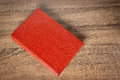 Red book on the table Royalty Free Stock Photo
