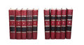 Red books covers with serial numbers. Retro book collection ten volumes, textured leather. White background, soft focus Royalty Free Stock Photo