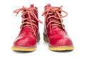 Red boots and untied shoelaces on the white background Stock Photos
