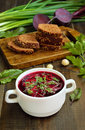 Red borscht soup with dill in white bowl Royalty Free Stock Photo
