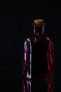 Red bottle on black Royalty Free Stock Image