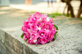 Red bouquet on gray parapet of roses lying the stone Stock Photos