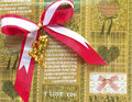 Red bow on brown gift wrapping paper shiny satin ribbon Stock Image