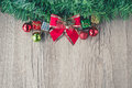 Red bow christmas gift boxes and balls background on wooden texture Royalty Free Stock Photo
