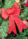 Red bow Christmas ornament tree, detail, close up Royalty Free Stock Photo