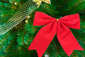 Red bow on christmas tree Royalty Free Stock Photos