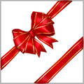 Red bow with diagonally ribbons with golden strips of wide ribbon Stock Photography