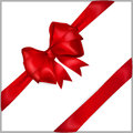 Red bow with diagonally ribbons of wide ribbon Royalty Free Stock Photography