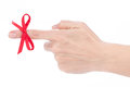 Red bow on female finger Royalty Free Stock Photo