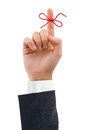 Red bow on finger Royalty Free Stock Photo