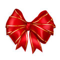 Red bow with golden strips of wide ribbon Stock Image
