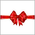 Red bow with horizontal ribbons with golden strips of wide ribbon Stock Images