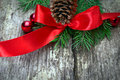 Red bow with pine cones and tree branches Stock Photos
