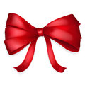 Red bow of thin ribbon with shadow Royalty Free Stock Images