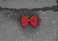 Red bow tie with black dots lying on the pavement of a street Stock Photo